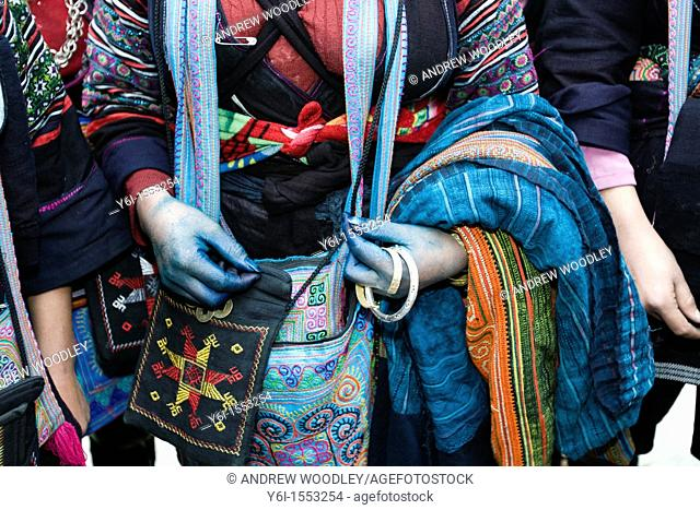 Black Hmong hilltribe woman with blue hands from dyed cloth Sapa Vietnam