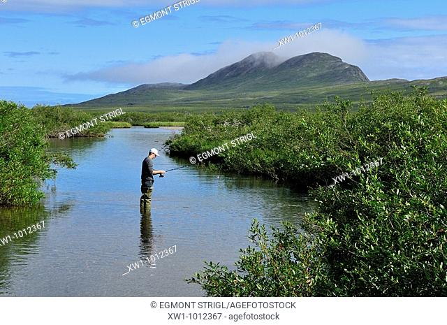 fisherman in a river, tundra valley in the Torngat Mountains National Park, Newfoundland and Labrador, Canada, North America