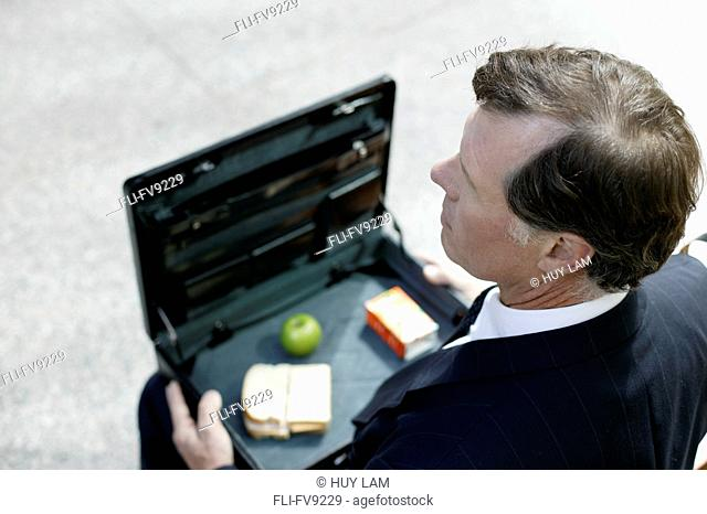 Businessman with Lunch in Briefcase, Toronto, Ontario