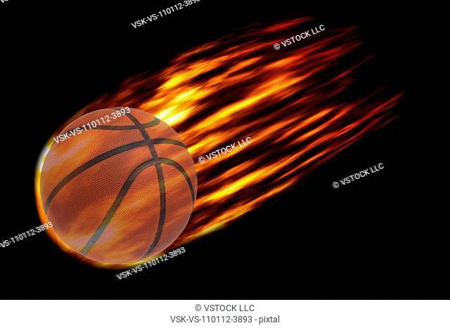 Composite image of burning basketball