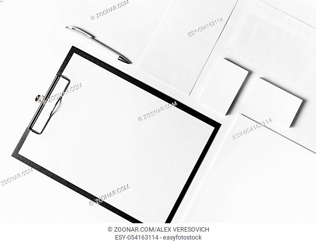 Photo of blank corporate stationery set with plenty of copy space on white paper background. Top view. Flat lay