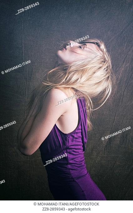 Beautiful young blond woman head up eyes closed