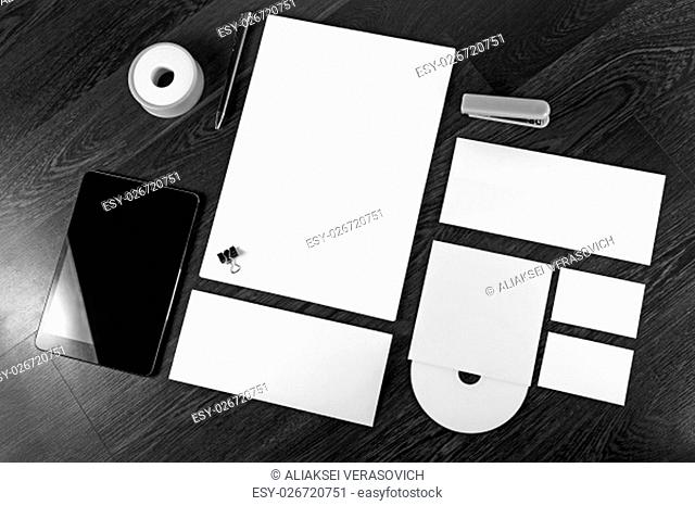 Photo of blank stationery and corporate identity template on wooden background. For design presentations and portfolios