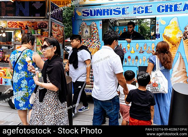 PRODUCTION - 11 July 2021, US, New York: People stand outside a mobile ice cream stand in Hudson Yards. New York is well on its way to making up for its...