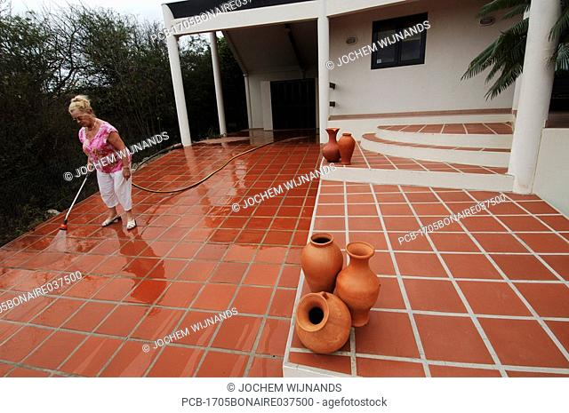 Netherlands Antilles, Bonaire, Real estate agent showing American clients a property