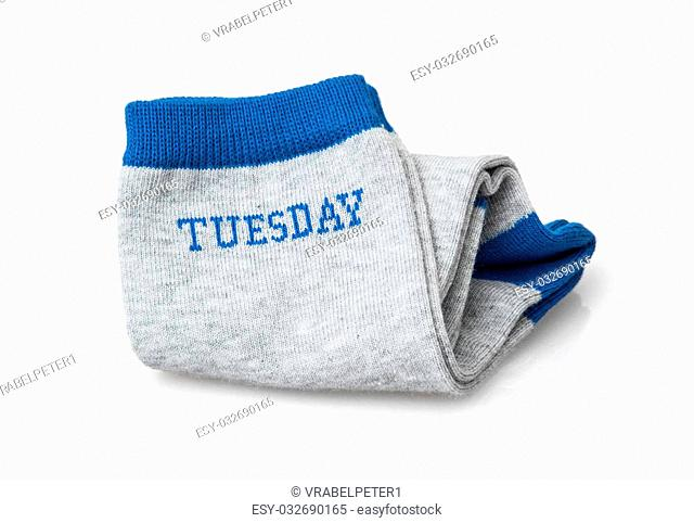 Trendy wool socks with inscription TUESDAY isolated on a white background