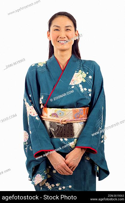 Smiling Japanese kimono woman isolated over white background
