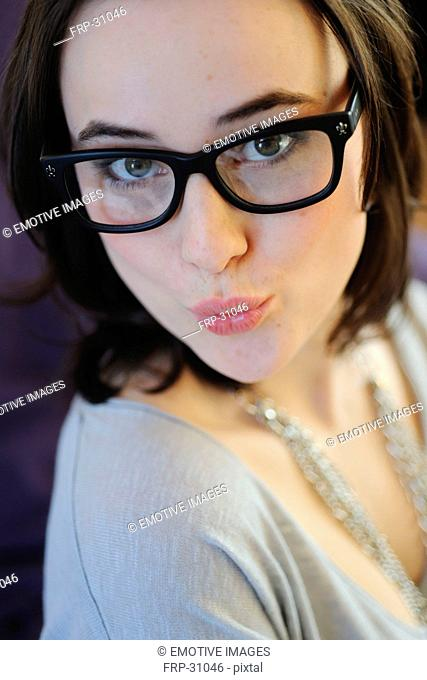 Brunette young woman with glasses pouting
