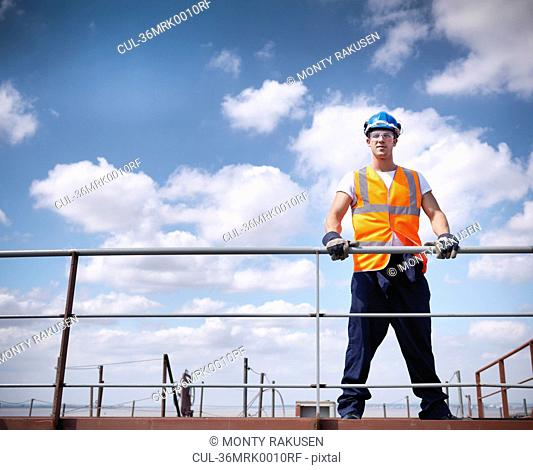 Worker standing on ship
