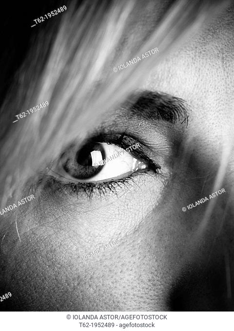 Close up of the eye of a young attractive caucasian woman, black and white