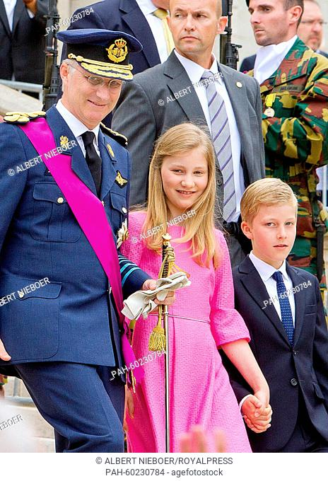 King Philippe of Belgium (L-R), Crown Princess Elisabeth and Prince Emmanuel walk together after the Te Deum mass at the Cathedral of St