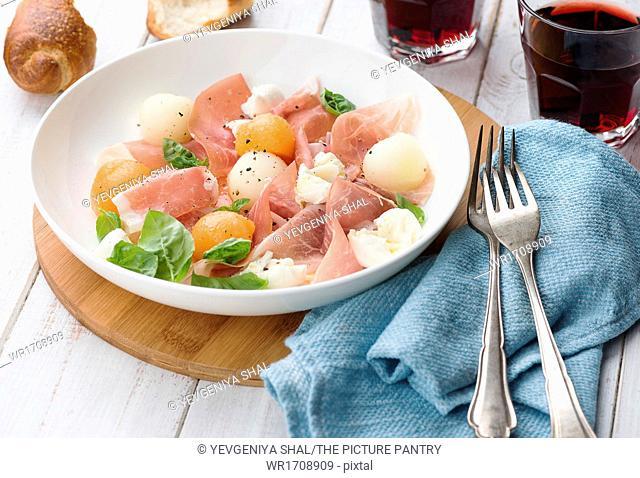 Melon and prosciutto ham salad with Mozzarella