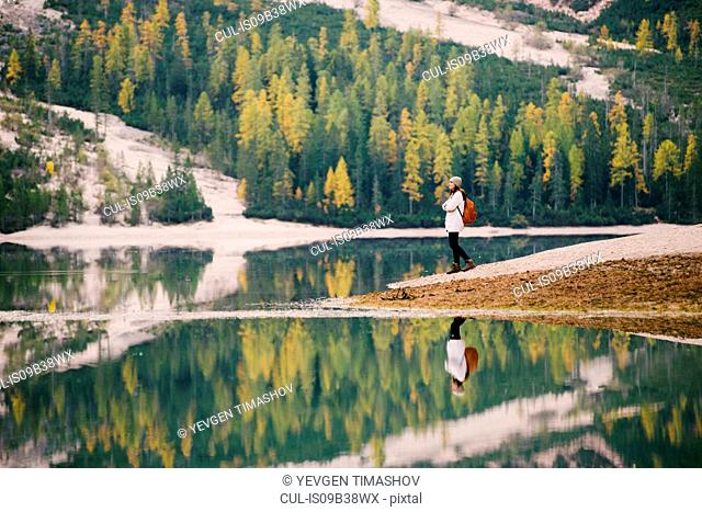 Woman enjoying view, Lago di Braies, Dolomite Alps, Val di Braies, South Tyrol, Italy