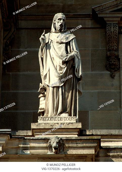 FRANCE, PARIS, 01.05.2007, Statue of Saint Gregory of TOURS, Bishop of Tours at the facade of The Louvre Museum - Palais Royal. Paris. France