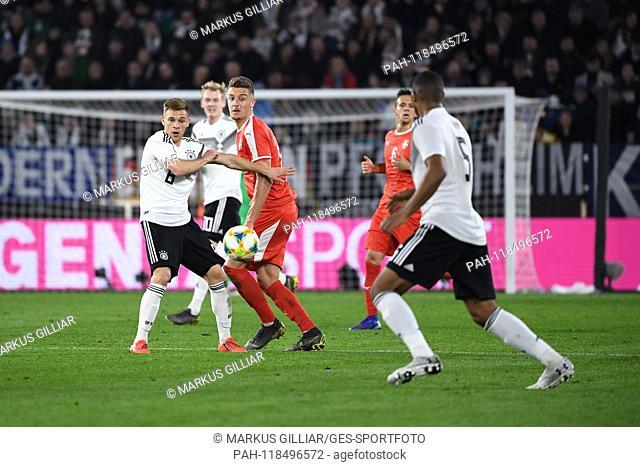 Joshua Kimmich (Germany), Sergei Milinkovic-Savic (Serbia) and Jonathan Tah (Germany). GES / Football / Test Match: Germany - Serbia, 20.03