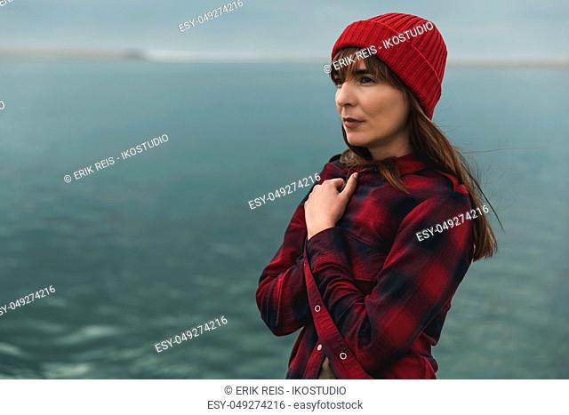 Beautiful woman felling cold near the lake