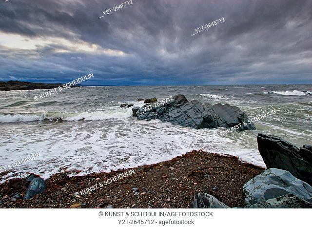 Stormy sky over the coast of Varangerfjorden near the Barvikmyran and Blodskytodden nature reserve in arctic Norway
