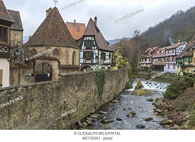Typical architecture of the old medieval town and bridge on river Weiss Kaysersberg Haut-Rhin department Alsace France Europe
