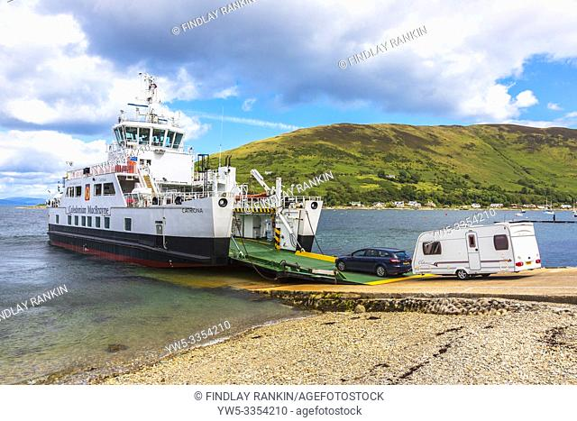 Car and caravan embarking on the Caledonian MacBrayne car ferry Catriona at the slipway at Lochranza, Isle of Arran near Newton Point on the Firth of Clyde