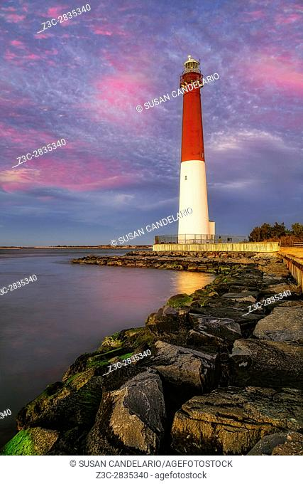 """Barnegat Bay Lighthouse Sunset - Barnegat Lighthouse or Barnegat Light, colloquially known as """"""""Old Barney"""""""", is a historic lighthouse located in Barnegat..."""