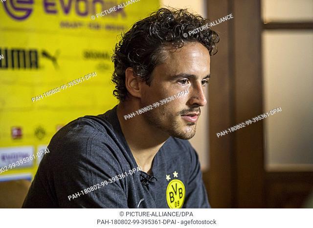 02 August 2018, Switzerland, Bad Ragaz: Soccer, training camp Borussia Dortmund: Dortmund's player Thomas Delaney speaks during an interview