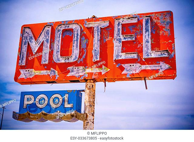 An old direpit, flaking neon motel sign in the American Desert