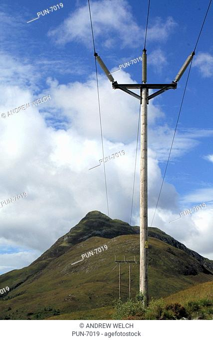 Electricity pylons carrying cables across the Mamore mountains above Kinlochleven
