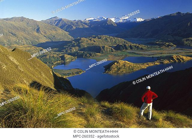 Hiker on Mt  Roy with Mt  Aspiring in the distance above Lake Wanaka, Central Otago, New Zealand