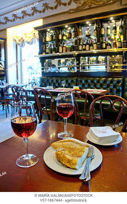 Spanish appetizer: Spanish omelet and two glasses of rose wine in a typical cafe. Madrid, Spain