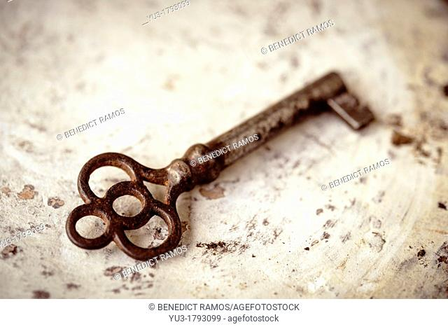 Old key on a distressed background