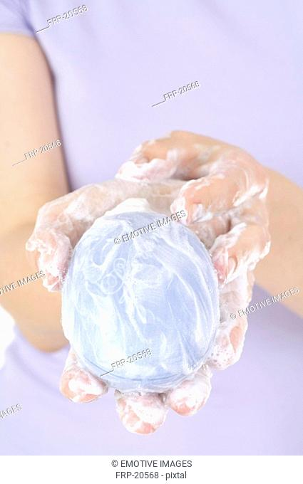 Woman has a hand wash with lavender soap