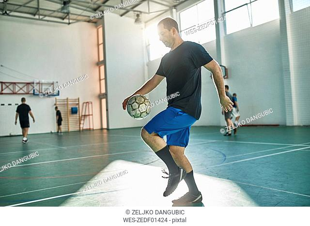 Indoor soccer player balancing the ball