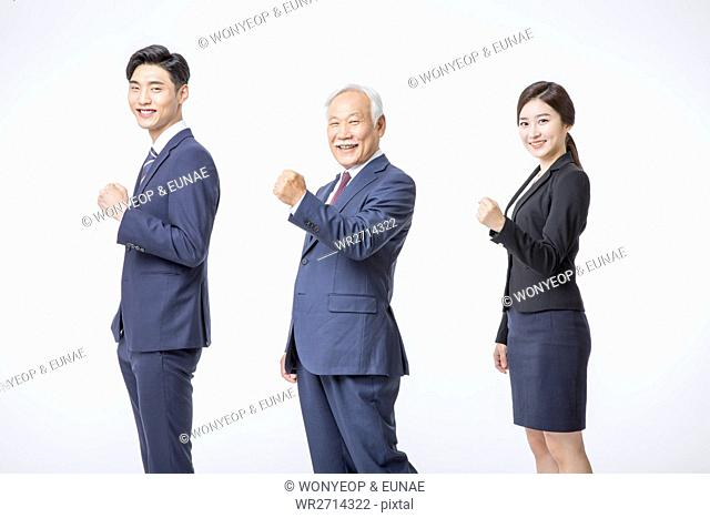 Smiling business people in suits