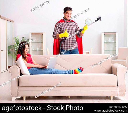 The superhero husband helping his wife at home