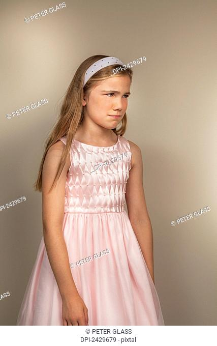 A young girl with an unhappy facial expression; Connecticut, United States of America