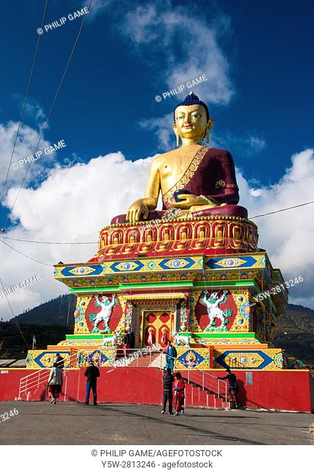 Gilded Buddha commanding a hilltop above Tawang near the border with Chinese-occupied Tibet, Arunachal Pradesh, NE India