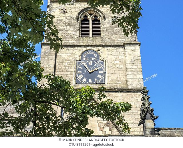 The tower at St Johns church with the Redeeming the Time inscription above the clock Knaresborough North Yorkshire England