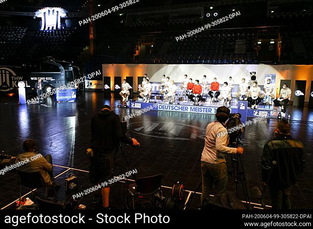 04 June 2020, Schleswig-Holstein, Kiel: The players of the German handball champion THW Kiel sit on a podium with distance and mouth and nose protection and...