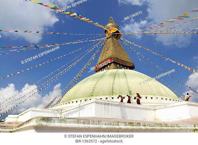 Three monks, Buddhist stupa of Bodhnath, Kathmandu, Nepal, Asia