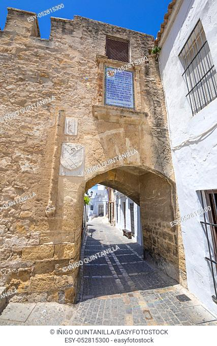 ancient Segur Gate, from XV century, in public street of typical Andalusian village named Vejer de la Frontera (Cadiz, Andalusia, Spain, Europe)