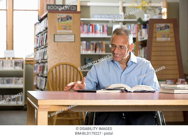 Caucasian man reading in library