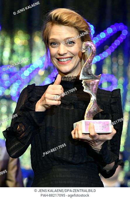 German actress Heike Makatsch poses with her award at theItalian film ball 'Notte delle Stelle' held during the 67th International Berlin Film Festival
