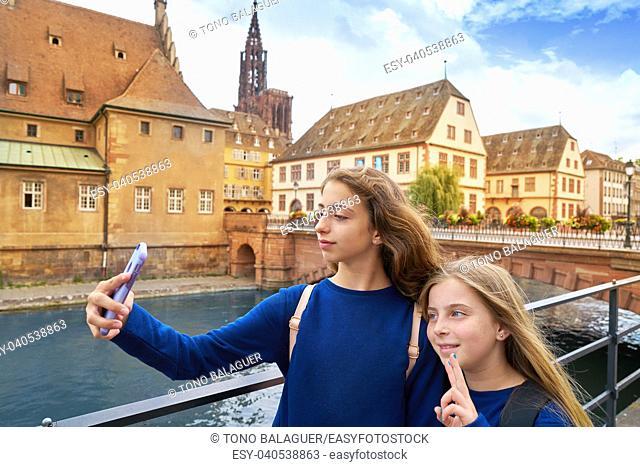 Strasbourg city kids girls selfie tourist photo in Alsace France