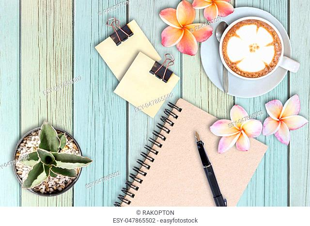 cactus, fountain pen, flowers and coffee latte on wooden table, idea concept, flat lay