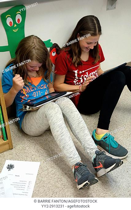 6th Grade Girls Using iPads for Science Research, Wellsville, New York, USA