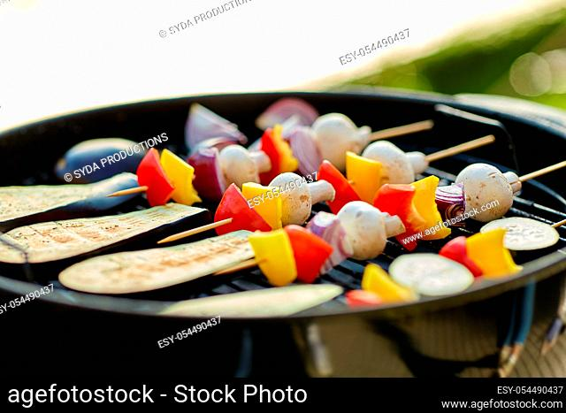 vegetables and mushrooms roasting on brazier grill