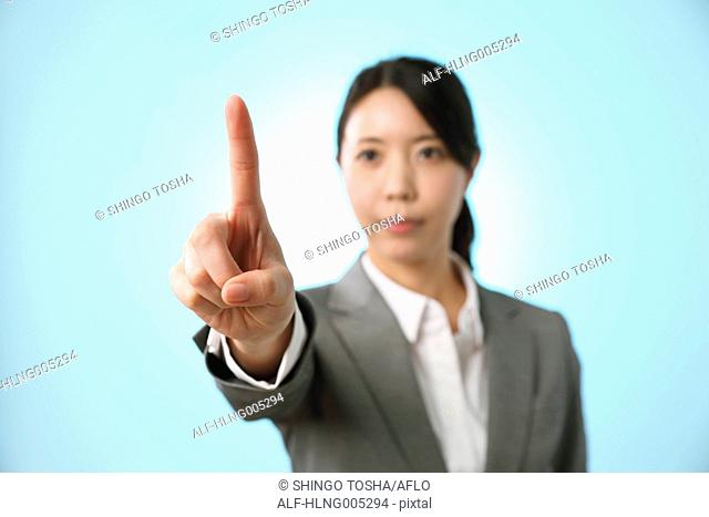 Japanese woman performing touch gesture