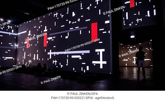 Visitors pass artworks by Piet Mondrian in the 'Von Monet bis Kandinsky' (From Monet to Kandinsky) multimedia exhibition in Berlin,Germany, 20 July 2017