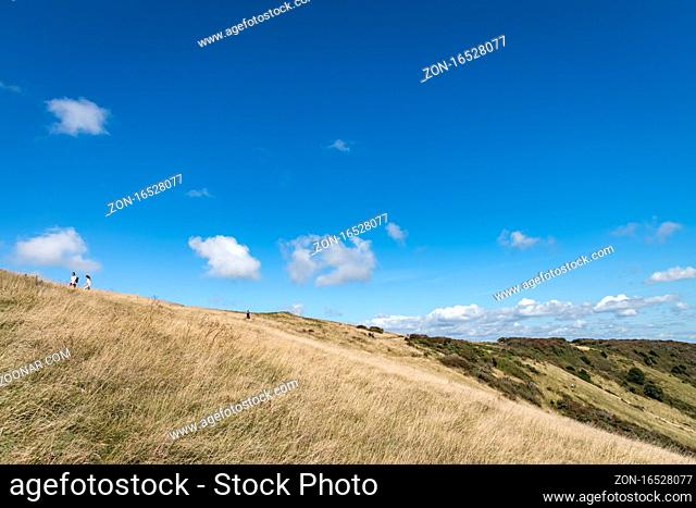 ALFRISTON, EAST SUSSEX/UK - SEPTEMBER 6 : People walking over the South Downs on a summers day near Alfriston in East Sussex on September 6, 2020
