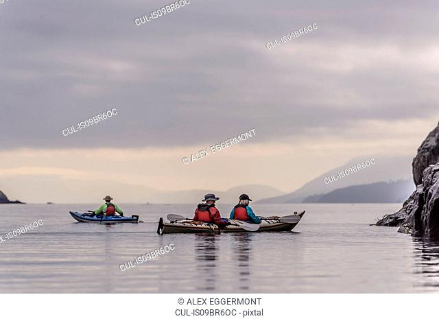 Friends kayaking in lake, Johnstone Strait, Telegraph Cove, Canada